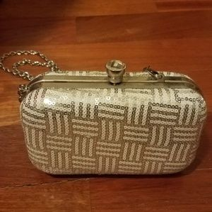 Cache silver sequined clutch